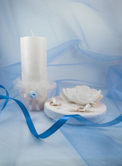 beautiful wedding candle with a small pillow for wedding rings