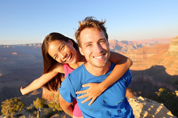 Active happy lifestyle couple hiking Grand Canyon