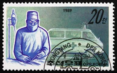 Postage stamp North Korea 1989 Surgeon and Ambulance