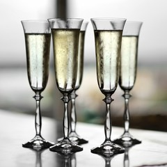 Five fancy glasses of champagne