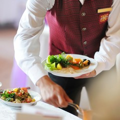 Waiter carrying a plate