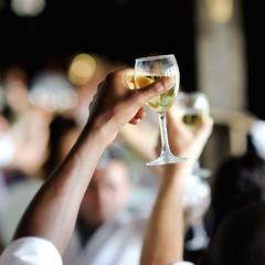Men's hand holding wine glass