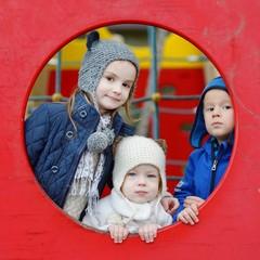 Three kids on a playground