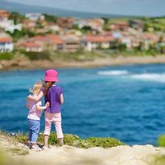 Two sisters enjoying a seascape
