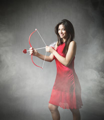 girl in red with bow and arrow