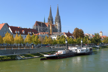 Regensburg Cathedral and old steamship at the shore of Danube