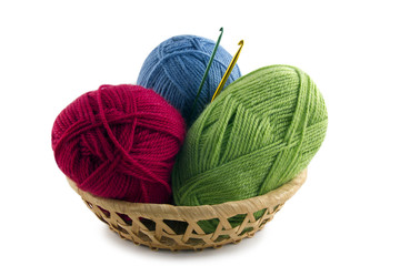 skeins and crochet hooks in a basket