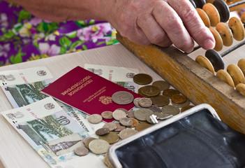 Elderly woman with money