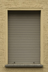 A Window with Rolling Shutters closed armored