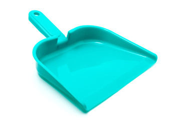 Green dustpan isolated on white background