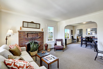 Room with brick fireplace in old american house
