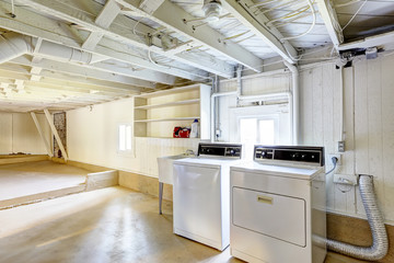 Empty basement in american house with laundry