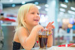 Adorable girl have meal with soda drink and fried potatoes at fa