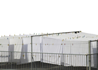 White cotton sheets drying on a rope