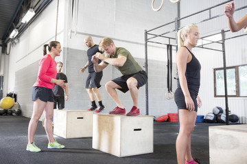 Workout group trains box jumps