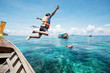 Snorkeling divers jump in the water - 69851896