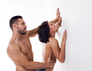 Excited young couple having sex standing
