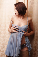 Young brunette woman wearing lingerie