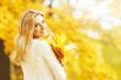 Smiling autumn woman