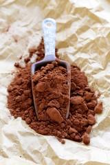 natural cocoa powder (chocolate) in a ceramic scoop