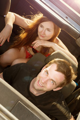 Couple in convertible car
