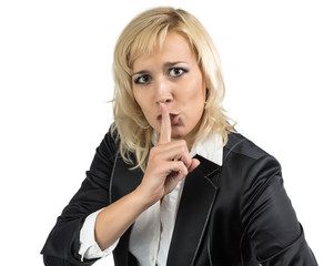 Business lady holding her finger near the mouth
