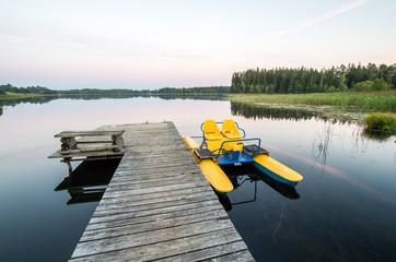Evening. Lake Plateliai and water bike in the lake