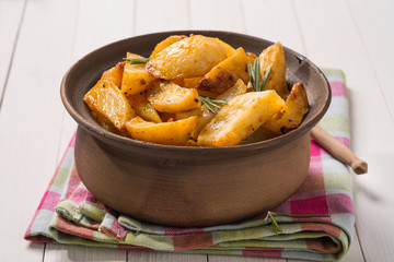 Baked potatoes in a clay pot