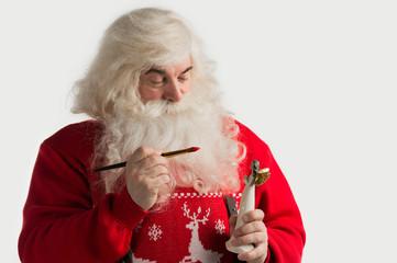 Santa Claus making toys