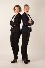Two business women in black suits