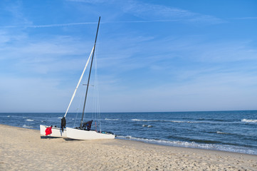 Sailing catamaran on the beach