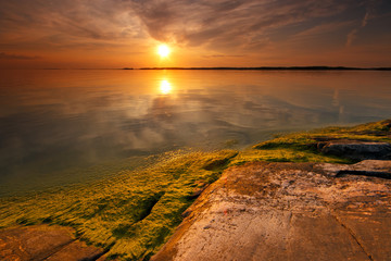 Warm, colorful and still summer evening seascape