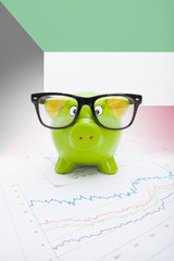 Piggy bank with flag on background - Kuwait