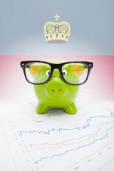 Piggy bank with flag on background - Liechtenstein