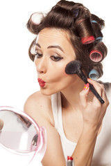 happy woman with curlers and bad makeup applied blush