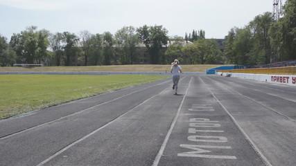 girl runs back view