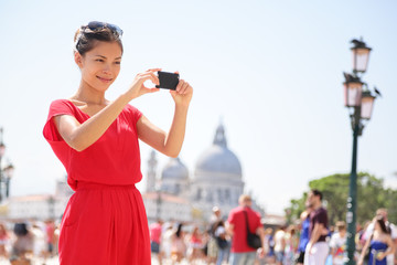 Asian woman taking picture photo in Venice, Italy