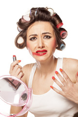 unhappy woman with curlers posing with smeared makeup