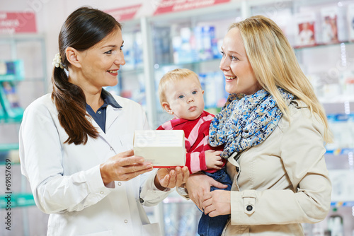 Pharmacy chemist, mother and child in drugstore - 69857659