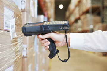 warehouse worker hand with scanner