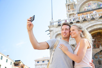 Couple on travel taking selfie photo Venice, Italy