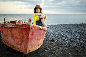 Beach, boat and young girl