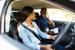 driving instructor giving thumbs up to learner driver - 69859420