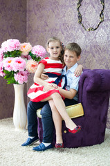 boy and girl sitting in the nice room