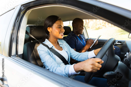 african woman taking driving test