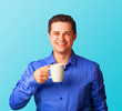 Casual man in shirt with cup on blue background.