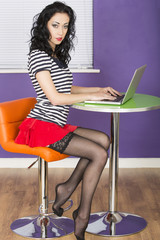 Sexy Young Woman Using a Laptop Computer
