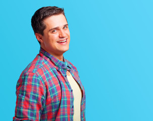 Casual man in shirt on blue background.