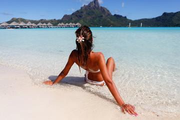 Sexy brunette on a beach in Bora Bora. French Polinesia