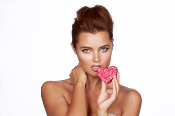 Beautiful sexy woman eating cake shape of heart valentine day